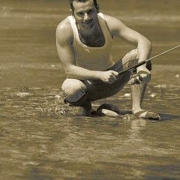 Photo of a Man fishing in a river